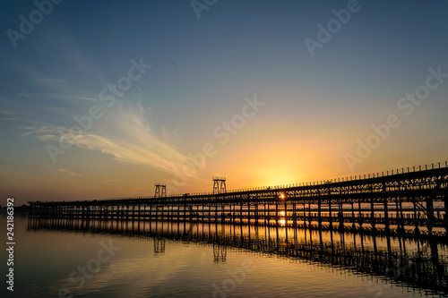 Sunset over the Rio Tinto Pier, Huelva, Andalusia, Spain
