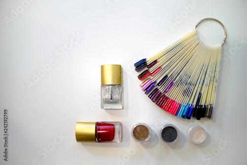 Fotografie, Obraz  Composition of nail polish, glitter and bright nail samples