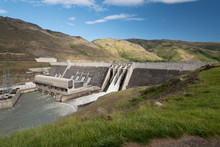 The Clyde Hydroelectric Power Dam Spilling Large Amounts Of Excess Water From Two Of Its Four Spillways. Clyde, Otago, New Zealand.