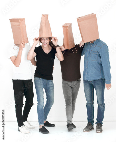 Fotografia  group of young people with paper bags on their heads