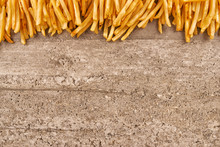 French Fries On Concrete Backg...