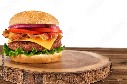 Cheeseburger with beef patty and bacon isolated on white background. Copy space for your text.