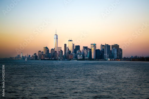 Photo Stands New York Approaching the Lower Manhatten skyline at sunset from Staten Island, New York City, United States
