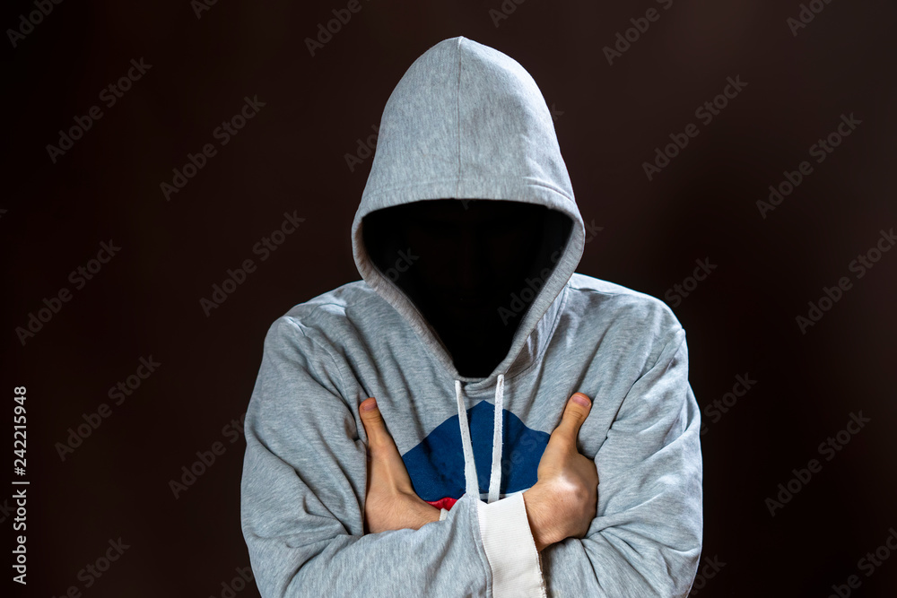 Fototapeta faceless incognito man wear hood on dark background isolated b