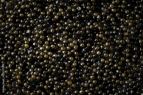 Black caviar background. High quality natural sturgeon caviar closeup. Delicatessen