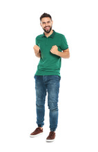 Happy Young Man Celebrating Victory On White Background