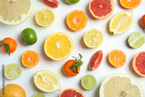 Different citrus fruits on white background, flat lay