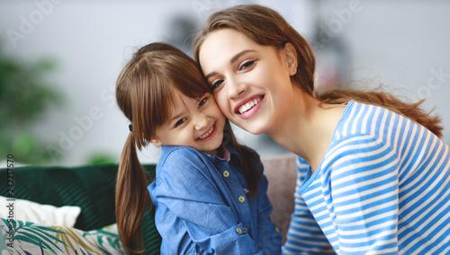 Spoed Foto op Canvas Wanddecoratie met eigen foto happy loving family mother and child daughter hugging at home.