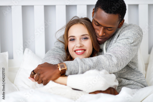 happy couple in love on winter morning in bed