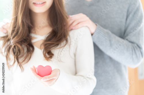 Fotografering  asian couple holding heart symbol