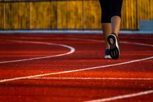 Red Running Track With Runner's Feet. Sport Stadium For Run.