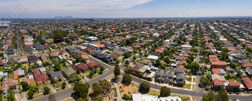 Fotografering Panoramic aerial view of the suburb of Preston in Melbourne, with the city high rise buildings in the background