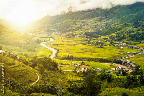 Beautiful sunrise on rice field terraced with tribe village in valley Canvas Print