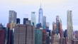 Freedom Tower on a gloomy day; dolly in; pan up; cinematic; aerial