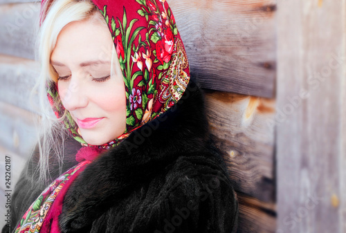 Poster Portrait Aquarelle portrait of a blond girl on the street, a girl in a red flower shawl and black coat