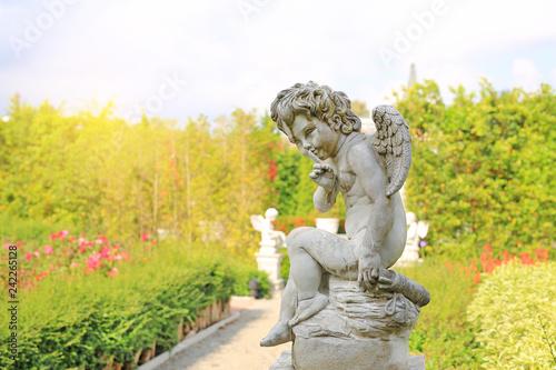 Photographie Cupid sculpture in summer garden outdoor.