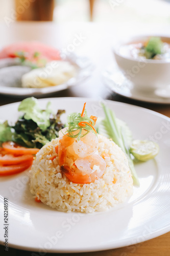 Fried rice with shrimp on wooden table Canvas Print