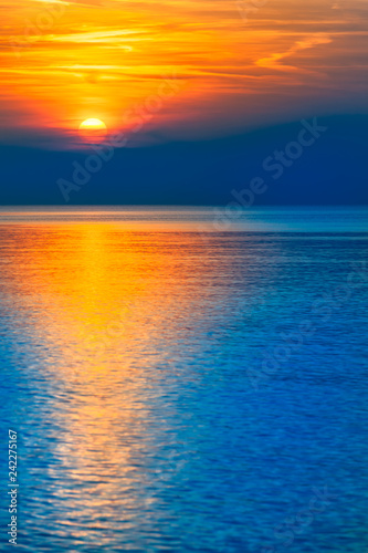 In de dag Meloen Gorgeous End of Day at the Sea / Natural spectacle - colorful blue and orange reflecting sunset at sea horizon (copy space)