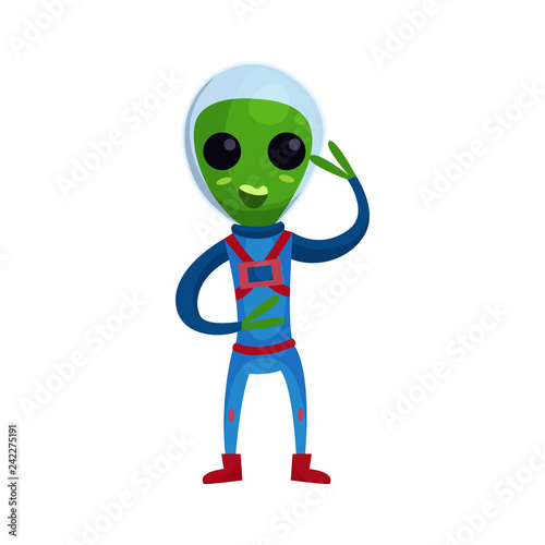 Fényképezés  Friendly smiling green alien with big eyes wearing blue space suit waving his ha