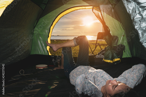 Garden Poster Fantasy Landscape Happy Asian woman travel camp in forest near mountain view and beach her resting and relax with backpack,tent at sunset.