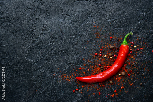 Poster Hot chili peppers Variety of pepper.Top view with copy space.