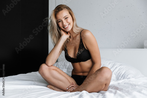 Fotografie, Obraz  Lovely young woman wearing lingerie