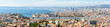 Panoramic view over the Old Port, the historic center of Le Panier, the Great Seaport of Marseille, the coastline and the north districts in the distance.
