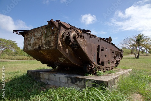Photo Stands Shipwreck Rusty ruins of a Japanese world war 11 tanker left on the roadside on Saipan, Northern Mariana Islands.