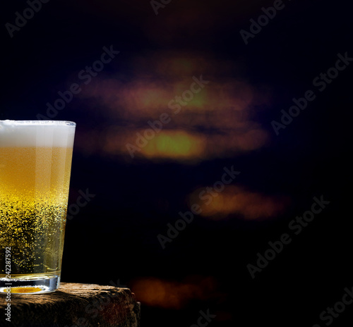 Foto op Canvas Bier / Cider Beer, beer glass on wooden table in dark pub