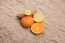 Studio Image Of Tangerine, Lemon, Ginger On Crumpled Paper. Lemon, Ginger And Mandarin For Lemonade.