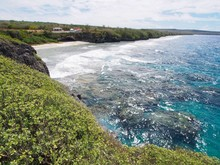 View Facing The Ladder Beach With Its Clear Blue Waters And Beachside Cottages On Top Of The Cliff