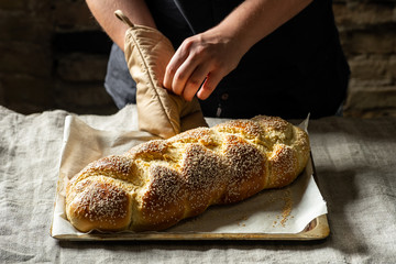 Raw challah traditional jewish bread covered with linen towel. Steps food concept.