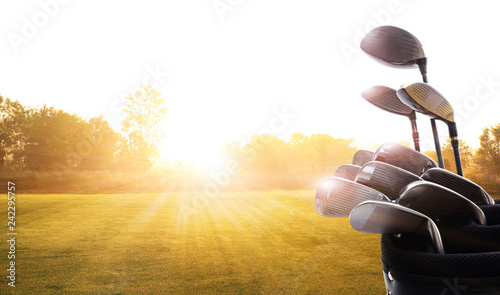 Foto auf Leinwand Golf Golf clubs drivers over beautiful golf course at the sunset, sunrise time. , morning time
