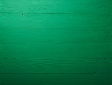 Green Wooden Background Or Table. Top View.