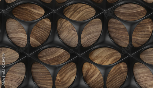 Valokuva  Black perforated solid construction on wooden background
