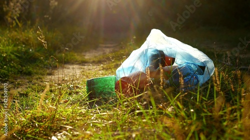 A package of plastic garbage lies in the forest on a forest road, pollution of n Canvas-taulu