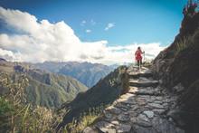 A Female Hiker Is Walking On T...
