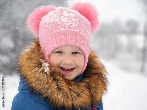 Fotografie, Obraz  Emotional portrait of a child. Girl smiles
