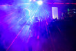 canvas print picture - Disco in a nightclub. Colored lights in the blur, people are dancing.