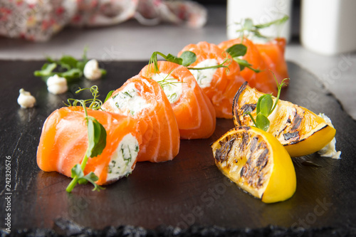 Poster Sushi bar Salmon rolls stuffed with cream cheese and herbs, beautiful snack, elegant food for menu