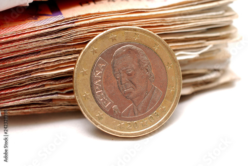 Valokuva  two euro coin on a banknote background,