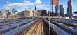 Panoramic view of Hudson Yards train station with the Midtown Manhattan skyline in the background taken from the High Line Park in New York City