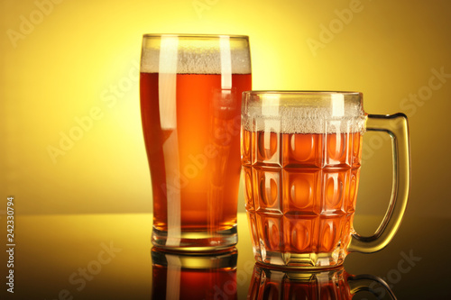 Foto op Canvas Bier / Cider Two Beer Mug / Glass with froth with reflection
