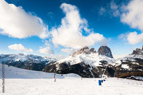 Ski slope in ski resort in Dolomite Alps. Val Di Fassa, Italy
