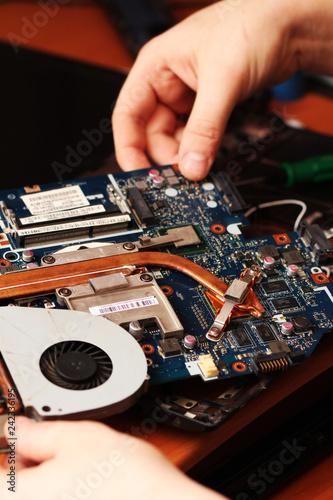 Fotomural  technician repairing computer hardware