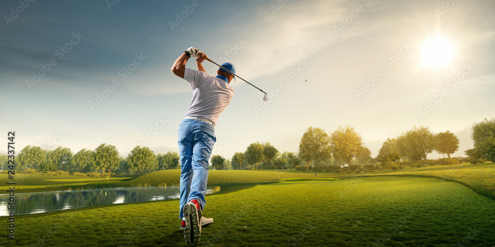 Fototapety, obrazy: Male golf player on professional golf course. Golfer with golf club taking a shot