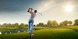 canvas print picture - Male golf player on professional golf course. Golfer with golf club taking a shot