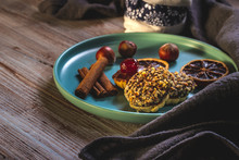 Few Pieces Of Baked Sweets With Nut Pieces And Chocolate On Blue Plate