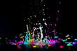 Leinwandbild Motiv Dancing color ink on black background