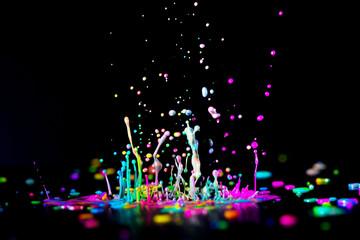 Dancing color ink on black background